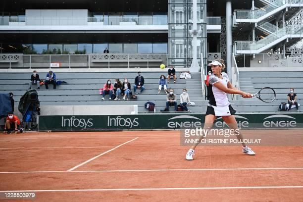 Belgium's Elise Mertens returns the ball to Estonia's Kaia Kanepi during their women's singles second round tennis match on Day 4 of The Roland...