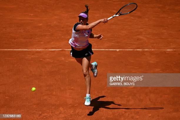 Belgium's Elise Mertens returns the ball to Romania's Simona Halep during their 2021 WTA Tour Madrid Open tennis tournament singles match at the Caja...