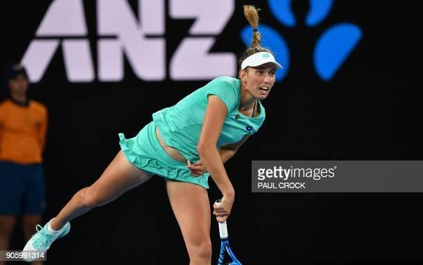 Belgium's Elise Mertens serves during her women's singles second round match against Australia's Daria Gavrilova on day three of the Australian Open...