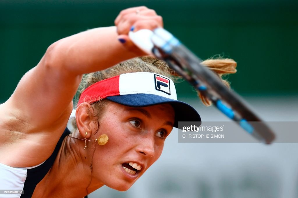 Belgium's Elise Mertens serves the ball to Australia's Daria Gavrilova during their tennis match at the Roland Garros 2017 French Open on May 29, 2017 in Paris. /