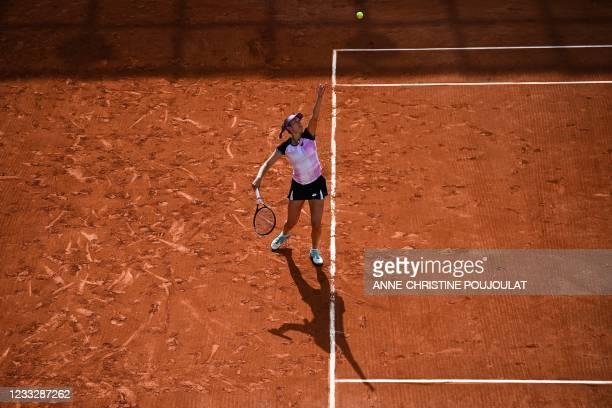 Belgium's Elise Mertens serves the ball to Greece's Maria Sakkari during their women's singles third round tennis match on Day 7 of The Roland Garros...