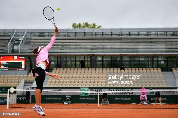 Belgium's Elise Mertens serves the ball to Russia's Margarita Gasparyan during their women's singles first round tennis match at the Simonne Mathieu...