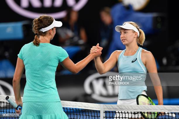 Belgium's Elise Mertens shakes hands as she celebrates after victory in her women's singles second round match against Australia's Daria Gavrilova on...