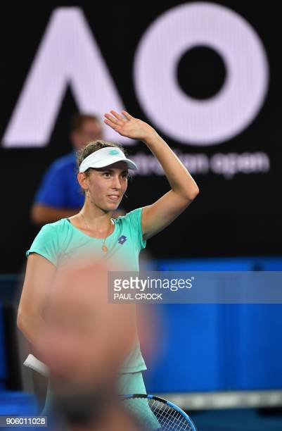 Belgium's Elise Mertens waves as she celebrates after victory in her women's singles second round match against Australia's Daria Gavrilova on day...