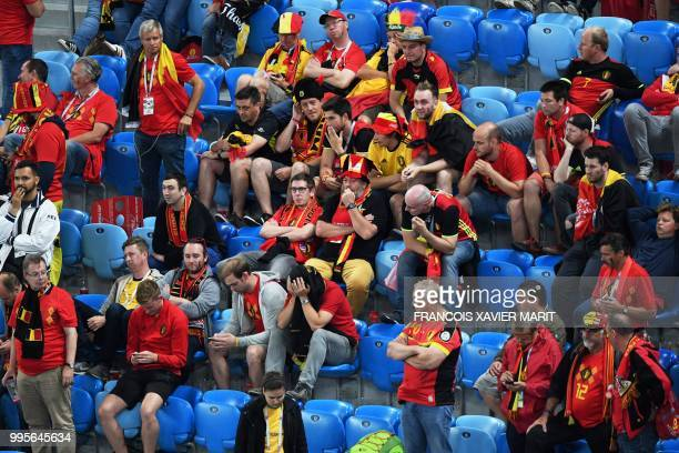 Belgium's fans react at the end of the Russia 2018 World Cup semifinal football match between France and Belgium at the Saint Petersburg Stadium in...