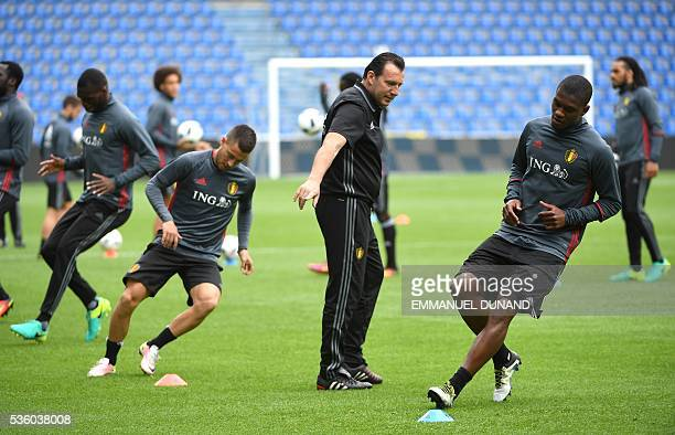 Belgium's football coach Marc Wilmots gives instructions to players during a training session ahead of the Euro 2016 football tournament on May 31 in...