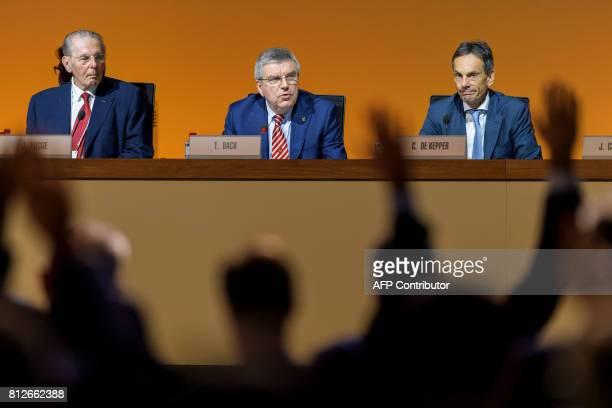 Belgium's former International Olympic Committee President Jacques Rogge International Olympic Committee President German Thomas Bach and Swiss IOC...