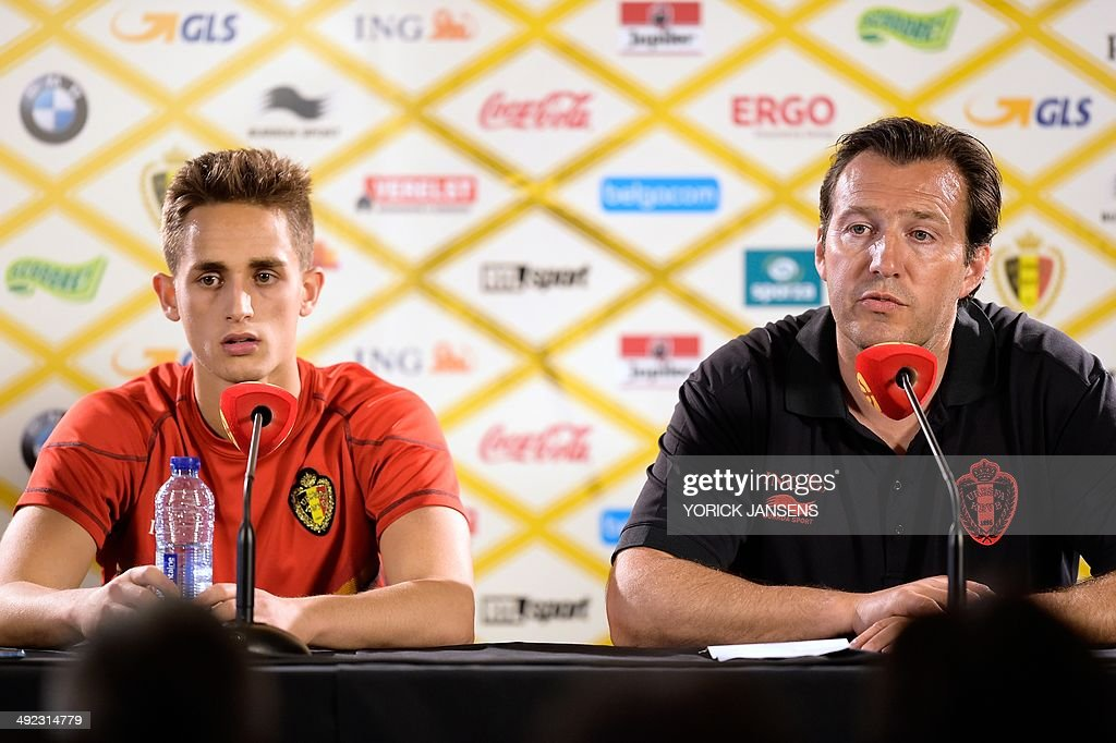 Belgium's forward Adnan Januzaj (L) and Belgium's head coach Marc Wilmots hold a press conference on the first day of the training camp of the Belgian national football team 'Red Devils' in Genk, on Monday 19 May 2014, ahead of the 2014 FIFA World Cup in Brazil. The Belgian Red Devils' training camp lasts from May 19 to June 8, 2014. AFP PHOTO / BELGA / YORICK JANSENS **Belgium Out**