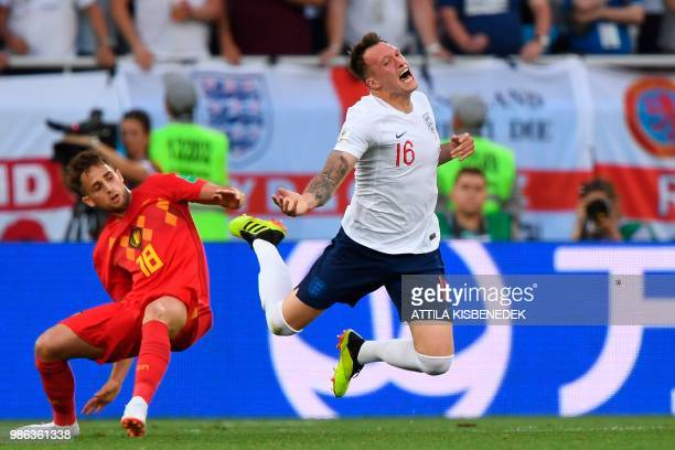 Belgium's forward Adnan Januzaj and England's defender Phil Jones vie for the ball during the Russia 2018 World Cup Group G football match between...
