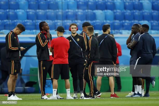 Belgium's forward Adnan Januzaj Belgium's defender Dedryck Boyata and teammates stand on the pitch before the Russia 2018 World Cup semifinal...