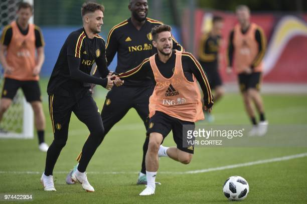Belgium's forward Adnan Januzaj Belgium's forward Romelu Lukaku and Belgium's forward Dries Mertens vie for the ball as they take part in a training...