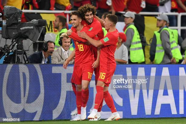Belgium's forward Adnan Januzaj celebrates scoring the opening goal with Belgium's midfielder Marouane Fellaini and Belgium's forward Thorgan Hazard...