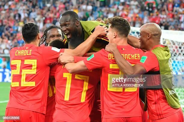 TOPSHOT Belgium's forward Adnan Januzaj celebrates scoring the opening goal with his teammates including forward Romelu Lukaku during the Russia 2018...