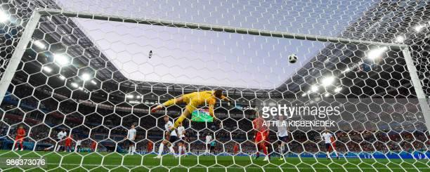 Belgium's forward Adnan Januzaj scores the opening goal past England's goalkeeper Jordan Pickford during the Russia 2018 World Cup Group G football...