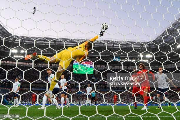 TOPSHOT Belgium's forward Adnan Januzaj scores the opening goal past England's goalkeeper Jordan Pickford during the Russia 2018 World Cup Group G...