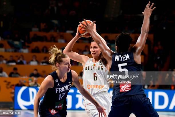Belgium's forward Antonia Delaere vies with France's guard Marine Johannes and France's forward Endene Miyem during the FIBA 2018 Women's Basketball...
