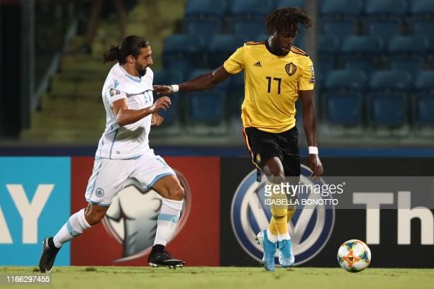 Belgium's forward Divock Origi outruns San Marino's midfielder Manuel Battistini during the Euro 2020 qualifier football match San Marino vs Belgium...