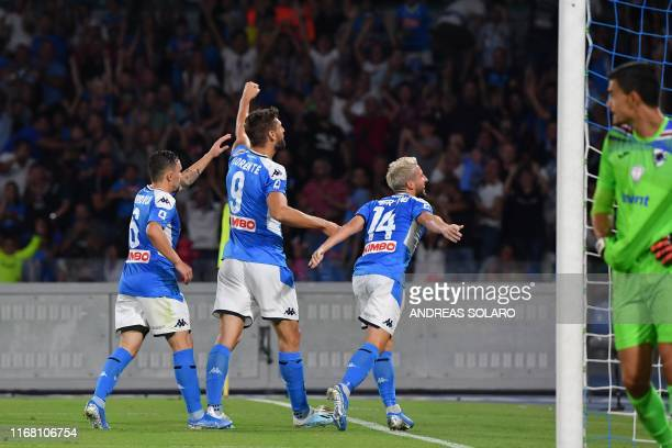 Belgium's forward Dries Mertens celebrates after the referee validated Mertens' second goal after checking the video assistant referee as Sampdoria's...