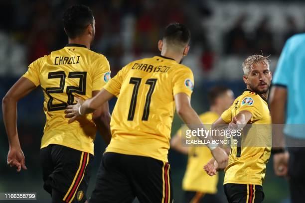 Belgium's forward Dries Mertens celebrates with Belgium's midfielder Yannick FerreiraCarrasco and Belgium's midfielder Nacer Chadli after scoring...