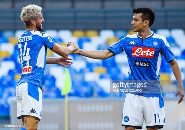 Belgium's forward Dries Mertens celebrates with Napoli's Mexican forward Hirving Lozano after opening the scoring during the Italian Serie A football...
