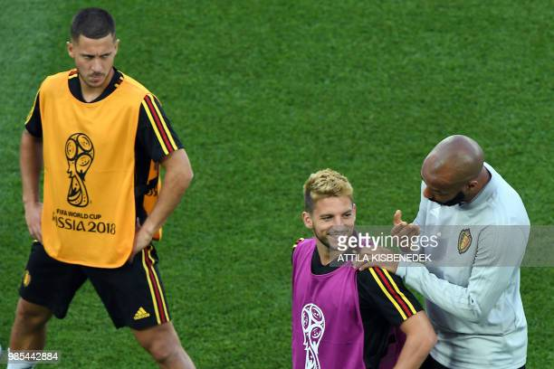 Belgium's forward Dries Mertens smiles beside Belgium's forward Eden Hazard during a training session on the eve of the Russia 2018 World Cup Group G...