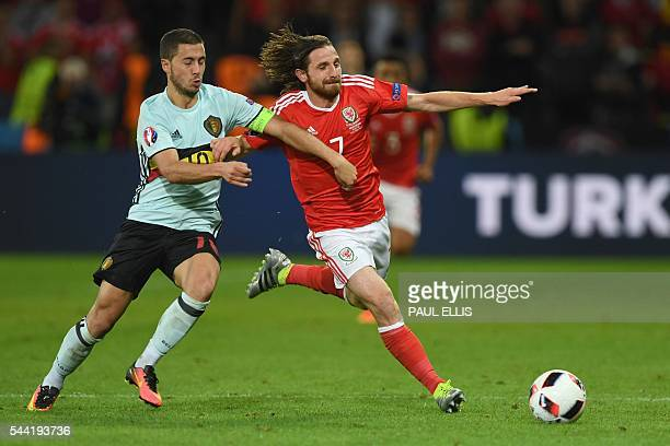 Belgium's forward Eden Hazard and Wales' midfielder Joe Allen vie for the ball during the Euro 2016 quarterfinal football match between Wales and...