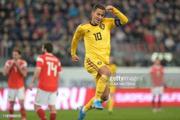 Belgium's forward Eden Hazard celebrates after scoring a goal during the Euro 2020 football qualification match between Russia and Belgium at the...