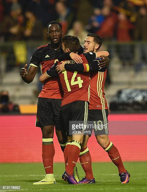Belgium's forward Eden Hazard celebrates after scoring during the FIFA World Cup 2018 football qualification match between Belgium and Bosnia and...