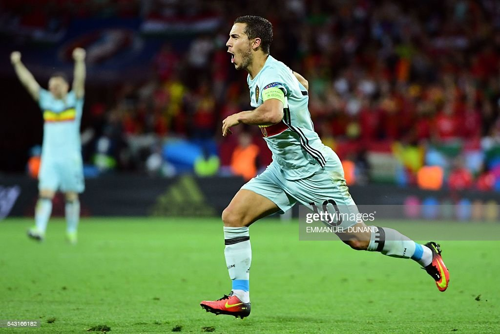 TOPSHOT - Belgium's forward Eden Hazard celebrates after scoring his team's third goal during the Euro 2016 round of 16 football match between Hungary and Belgium at the Stadium Municipal in Toulouse on June 26, 2016. / AFP / EMMANUEL