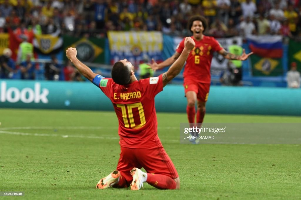TOPSHOT - Belgium's forward Eden Hazard celebrates their win during the Russia 2018 World Cup quarter-final football match between Brazil and Belgium at the Kazan Arena in Kazan on July 6, 2018. - Belgium beat World Cup favourites Brazil 2-1 on Friday to set up a semi-final against France in Saint Petersburg. (Photo by Jewel SAMAD / AFP) / RESTRICTED