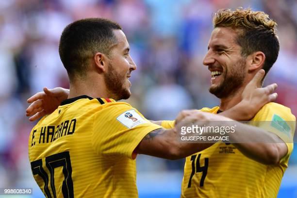 TOPSHOT Belgium's forward Eden Hazard celebrates with Belgium's forward Dries Mertens after scoring their second goal during their Russia 2018 World...