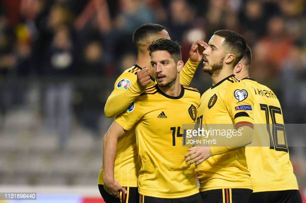 Belgium's forward Eden Hazard celebrates with teammates after scoring a goal during the Euro 2020 football qualification match between Belgium and...
