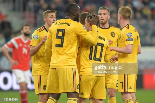 Belgium's forward Eden Hazard celebrates with teammates after scoring a goal during the Euro 2020 football qualification match between Russia and...