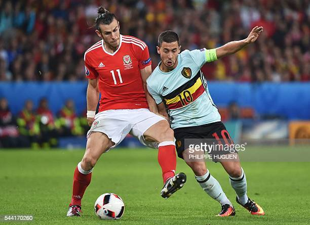 Belgium's forward Eden Hazard challenges Wales' forward Gareth Bale during the Euro 2016 quarterfinal football match between Wales and Belgium at the...