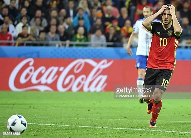 TOPSHOT Belgium's forward Eden Hazard reacts during the Euro 2016 group E football match between Belgium and Italy at the Parc Olympique Lyonnais...