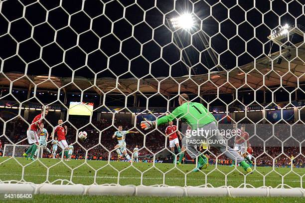 Belgium's forward Eden Hazard shoots to score his teams third goal during the Euro 2016 round of 16 football match between Hungary and Belgium at the...
