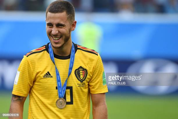 TOPSHOT Belgium's forward Eden Hazard smiles after receiving his bronze medal following their Russia 2018 World Cup playoff for third place football...