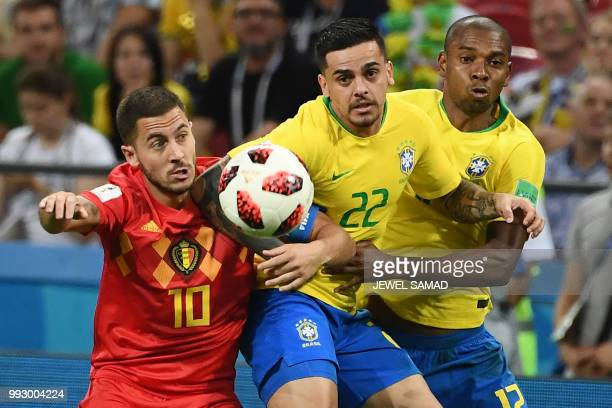 TOPSHOT Belgium's forward Eden Hazard vies for the ball with Brazil's defender Fagner during the Russia 2018 World Cup quarterfinal football match...