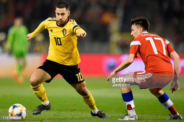 Belgium's forward Eden Hazard vies for the ball with Russia's midfielder Aleksandr Golovin during the Euro 2020 football qualification match between...