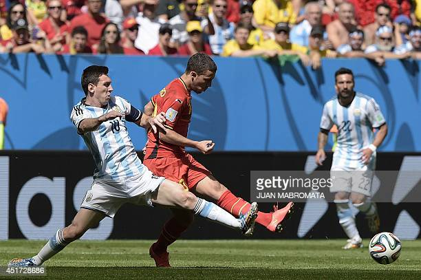 Belgium's forward Eden Hazard vies with Argentina's forward and captain Lionel Messi during a quarterfinal football match between Argentina and...
