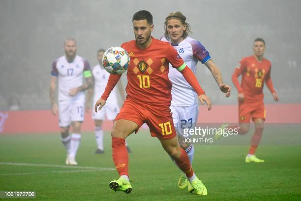 Belgium's forward Eden Hazard vies with Iceland's midfielder Ari Freyr Skulason during the UEFA Nations League football match between Belgium and...