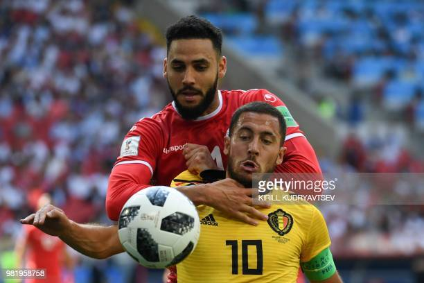 Belgium's forward Eden Hazard vies with Tunisia's defender Dylan Bronn during the Russia 2018 World Cup Group G football match between Belgium and...
