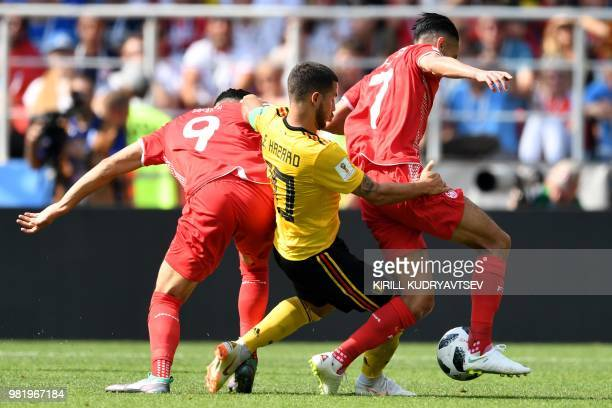 TOPSHOT Belgium's forward Eden Hazard vies with Tunisia's forward Anice Badri and Tunisia's midfielder SaifEddine Khaoui during the Russia 2018 World...