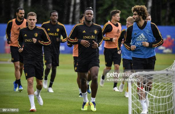 Belgium's forward Michy Batshuayi and midfielder Marouane Fellaini attend a training session in Dedovsk outside Moscow on July 4 ahead of the 2018...