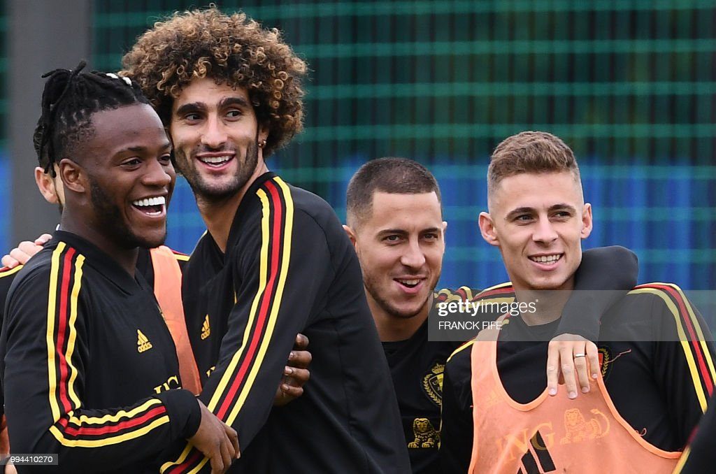 Belgium's forward Michy Batshuayi, Belgium's midfielder Marouane Fellaini, Belgium's forward Eden Hazard and Belgium's midfielder Thorgan Hazard joke during a training session at the Guchkovo Stadium in Dedovsk, outside Moscow, on July 9, 2018, on the eve of their Russia 2018 World Cup semi-final football match against France. AFP PHOTO / FRANCK FIFE