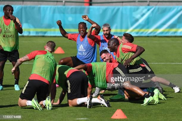 Belgium's forward Michy Batshuayi , Belgium's midfielder Yannick Ferreira-Carrasco and teammates joke during a training session at the team's base...