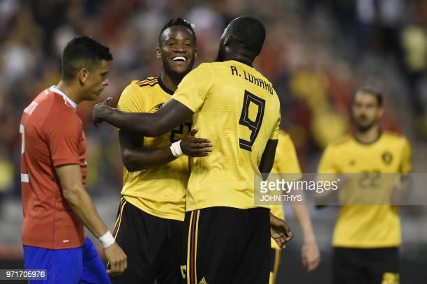Belgium's forward Michy Batshuayi celebrates with Belgium's forward Romelu Lukaku after scoring a goal during the international friendly football...