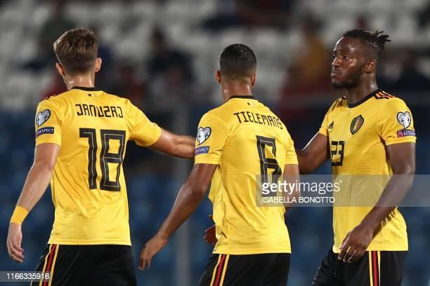 Belgium's forward Michy Batshuayi celebrates with teammates Belgium's midfielder Adnan Januzaj and Belgium's midfielder Youri Tielemans after opening...