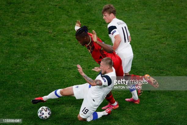 Belgium's forward Michy Batshuayi is marked by Finland's midfielder Joni Kauko and Finland's midfielder Rasmus Schuller during the UEFA EURO 2020...