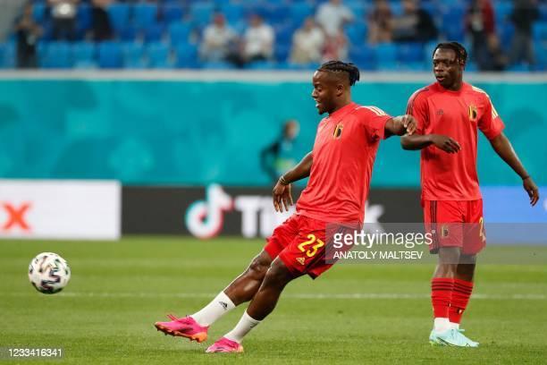 Belgium's forward Michy Batshuayi kicks the ball during warm up before the start of the UEFA EURO 2020 Group B football match between Belgium and...